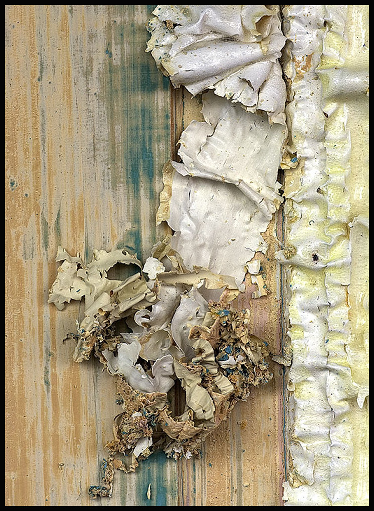Layers of old paint being removed