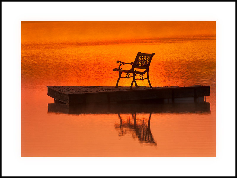 float and chair at sunrise on a pond