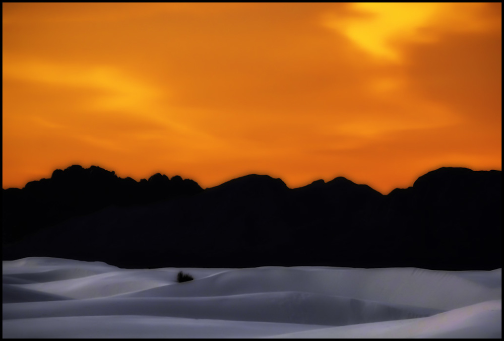 A soft glow of light falls on the white landscape