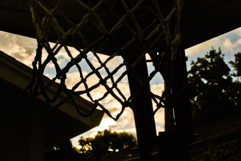 basketball net silhouette clouds