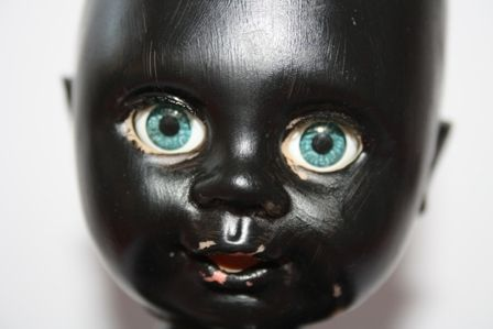Baby doll painted black