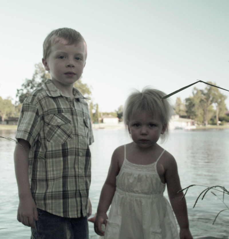Children in front of a lake