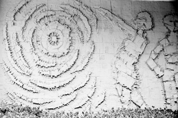 abstract art wall depicting sun worshipers