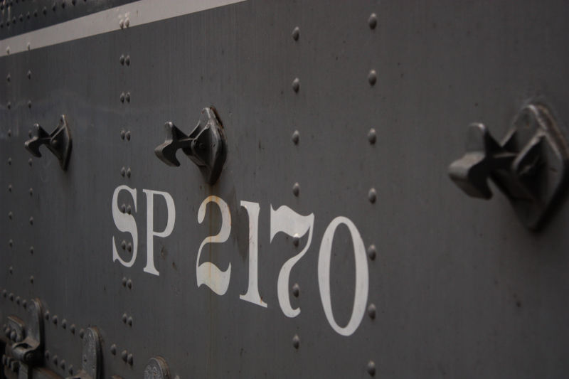 macro sho of the side of an old steam engine train