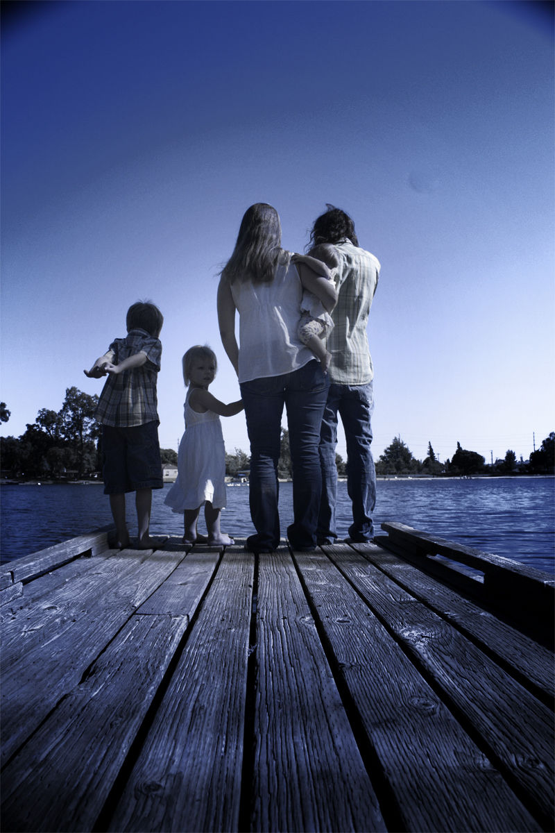 Family looking over lake