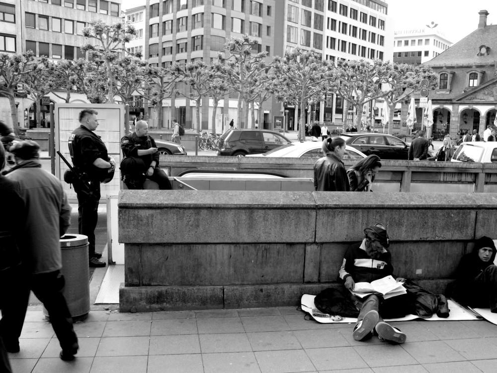Homeless Men and Riot Cops