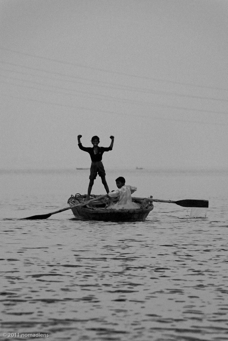 Boys on boat on Ganges at Varanasi, India