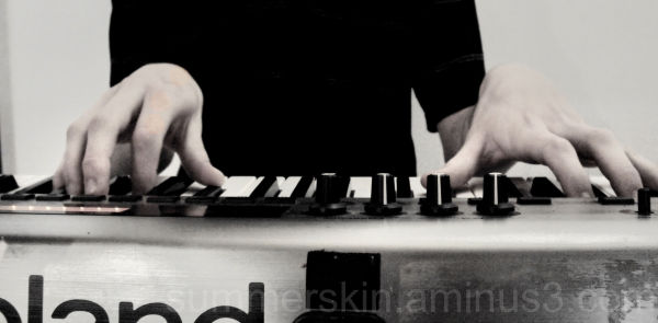 my friend playing his keyboard