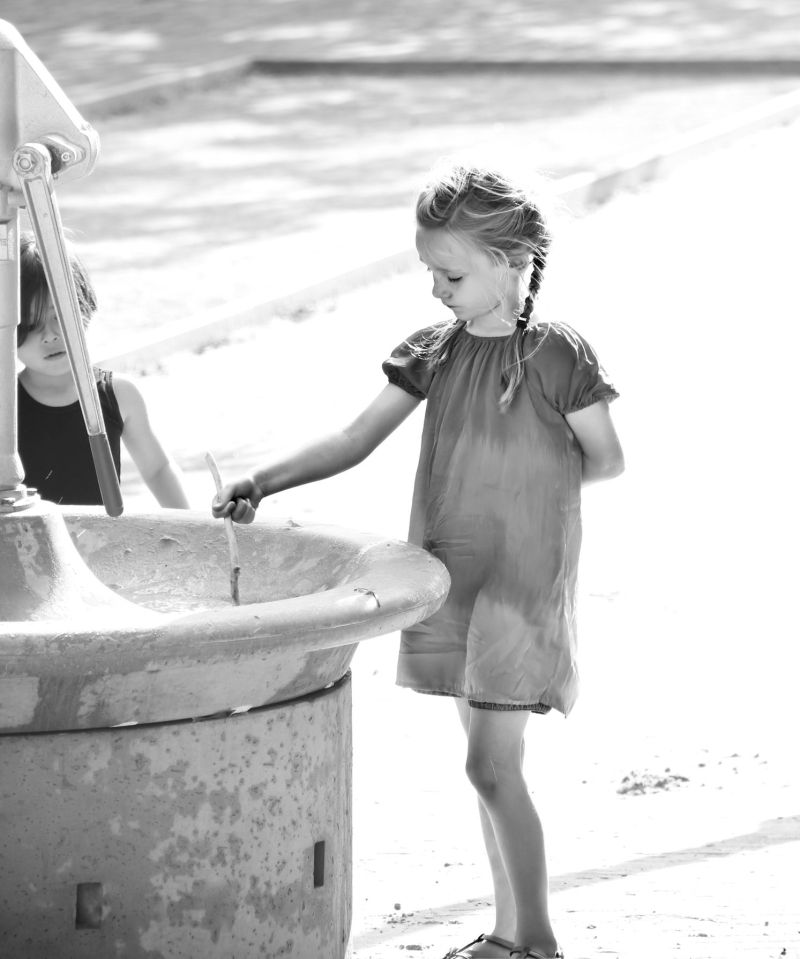 Girl at the watertank