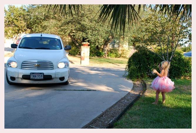 Kaia waving bye-bye to Daddy