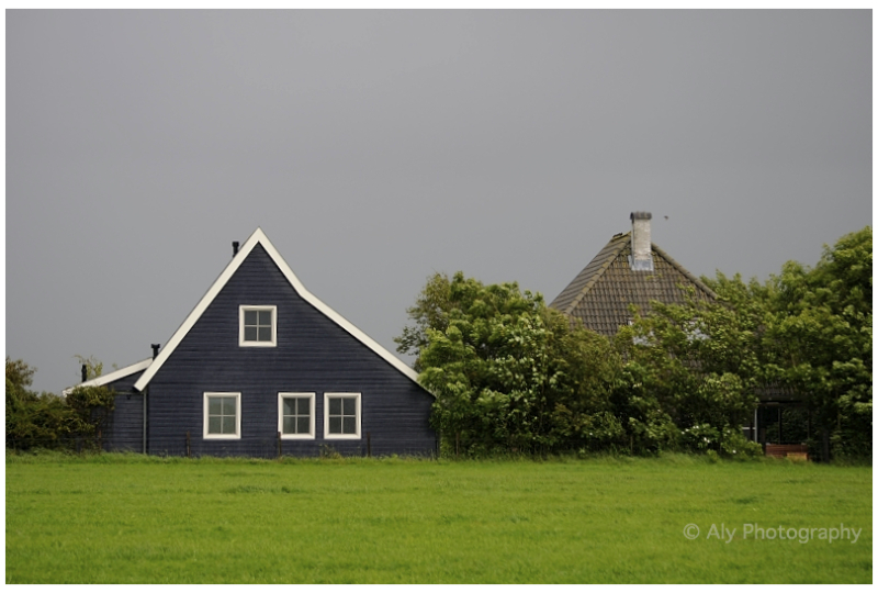 Blue wooden house in  the wind and rain