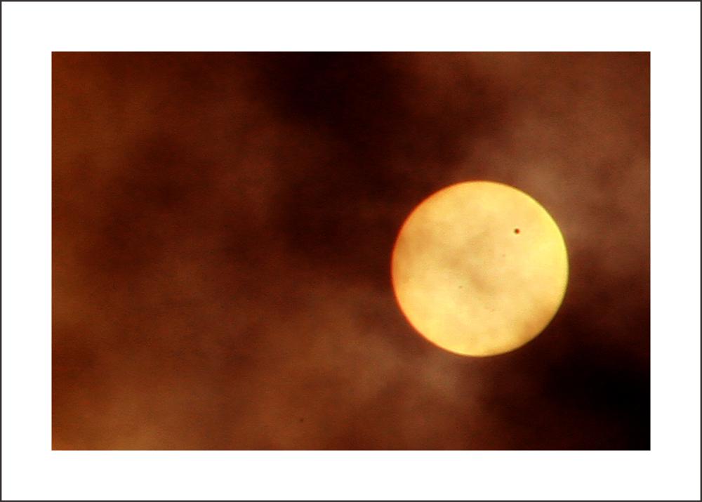 Planet Venus transiting the Sun