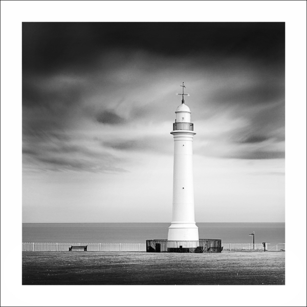 A fien art image of a lighthouse in black & white