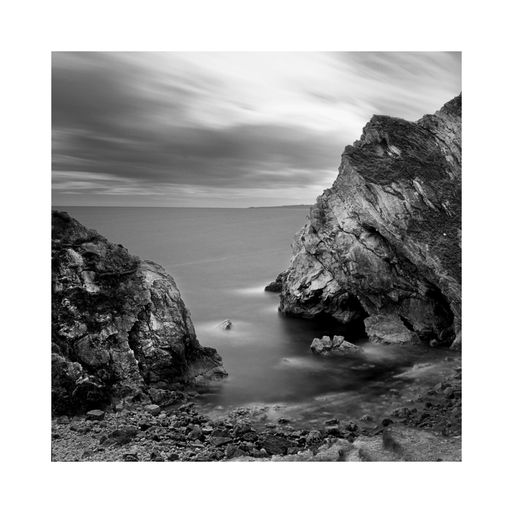 A black & white fine art photograph of a seascape