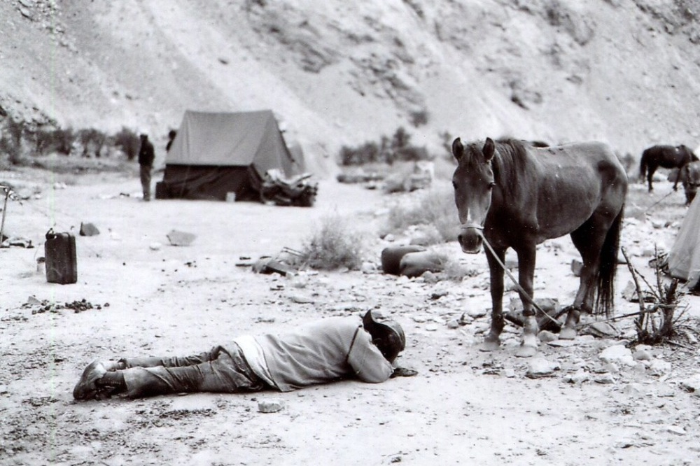 Lying Man with a Horse in Ladakh