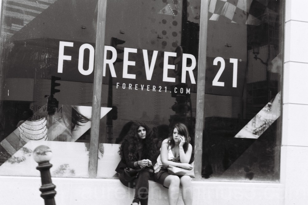 Two girls in front of a cloth shop
