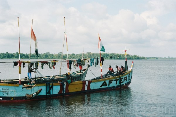 A colored boat with fishermen in Côte d'Ivoire
