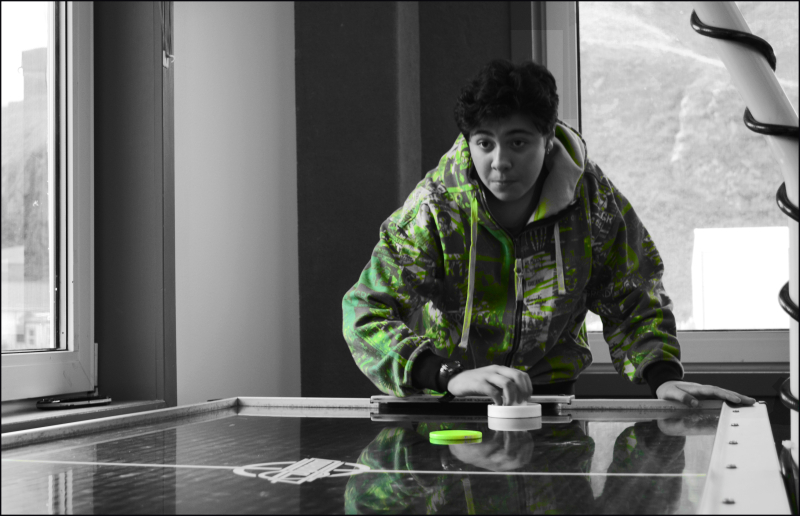 Teen playing air hockey