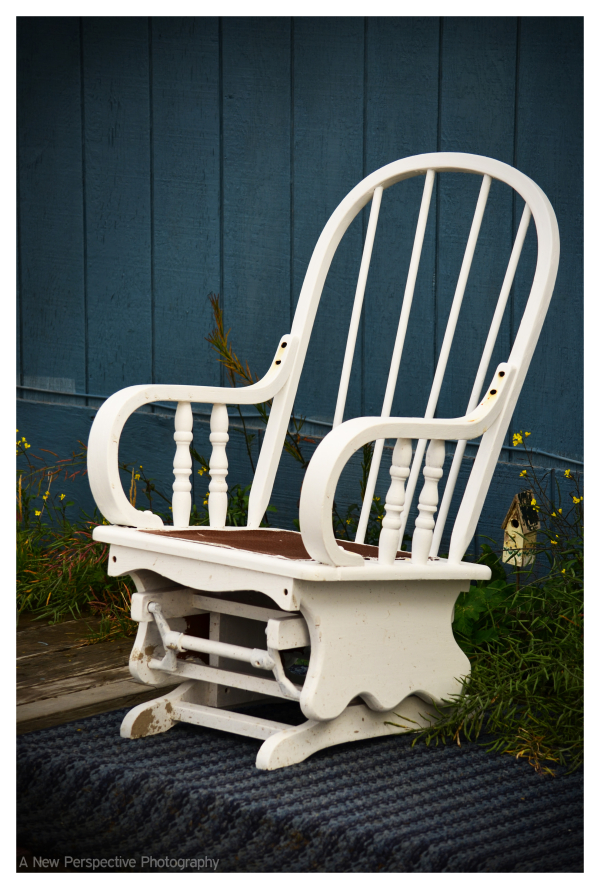 A rocking chair on someones porch in Unalaska