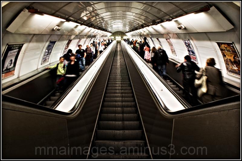passengers on escalator