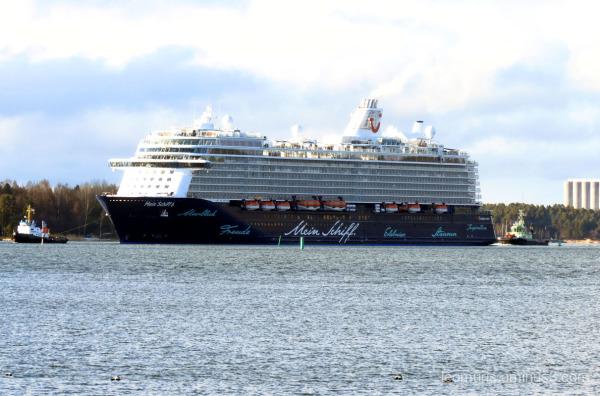 Big ship and tugs