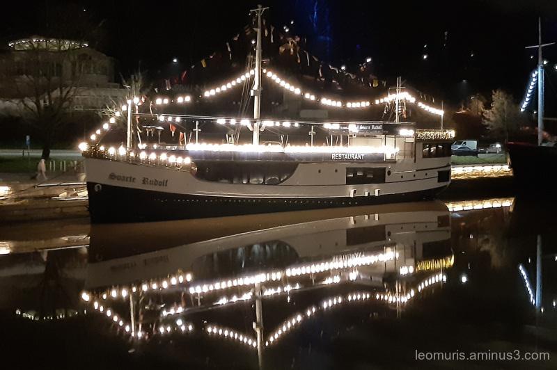 Lights on dark river