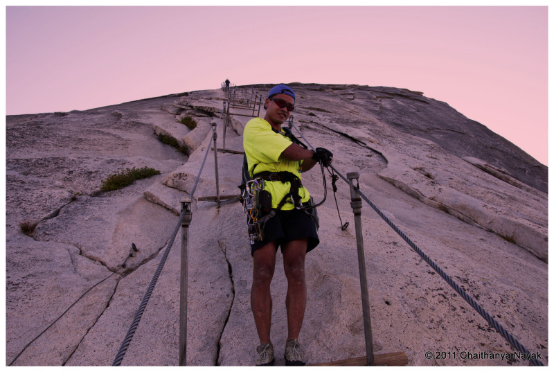 Rock Climber descending on Half Dome Cables