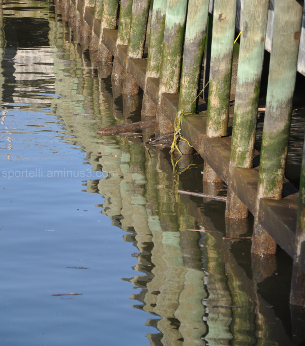 pier reflections on the water