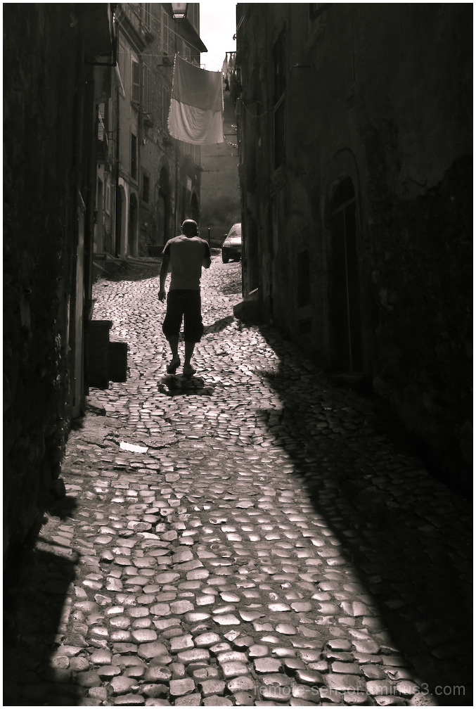 man walking in alley, tivoli