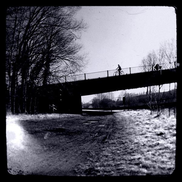 Biker on a bridge