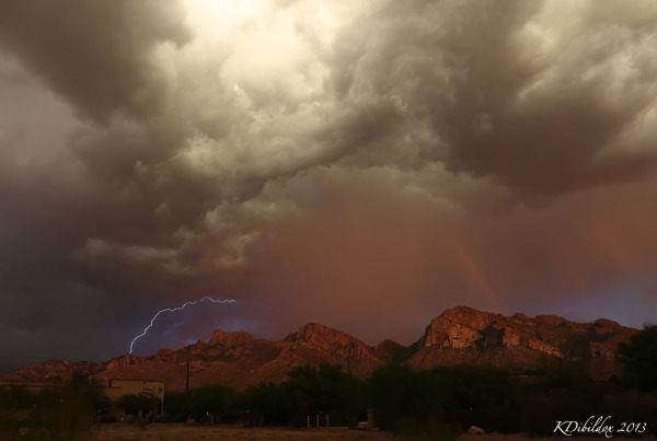 Lightning and a rainbow over the mountains