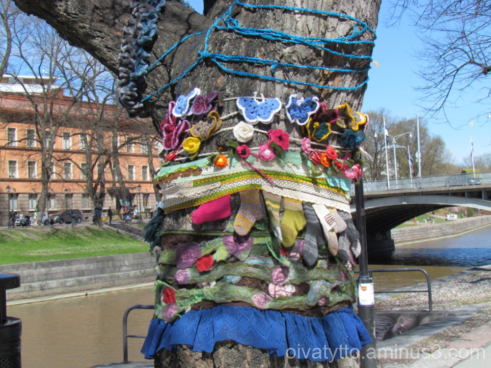 Trees river Aurajoki wrapped in knitwear.