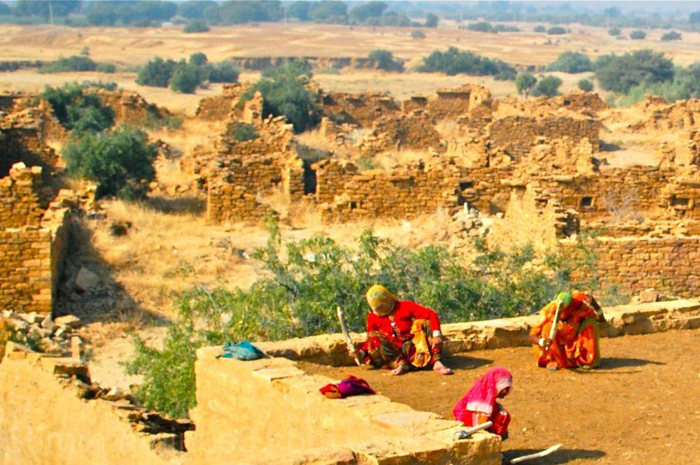 Women working on restoring an abandoned village