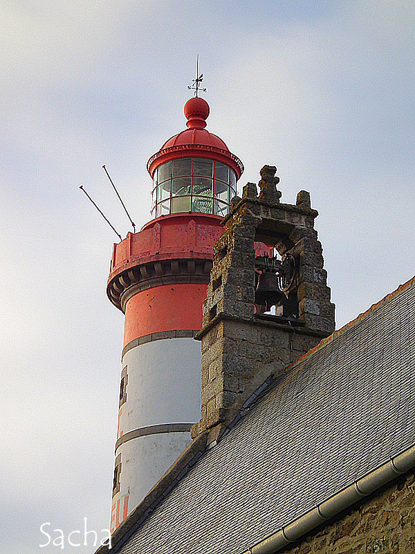 lighthouse and  a chapel bell