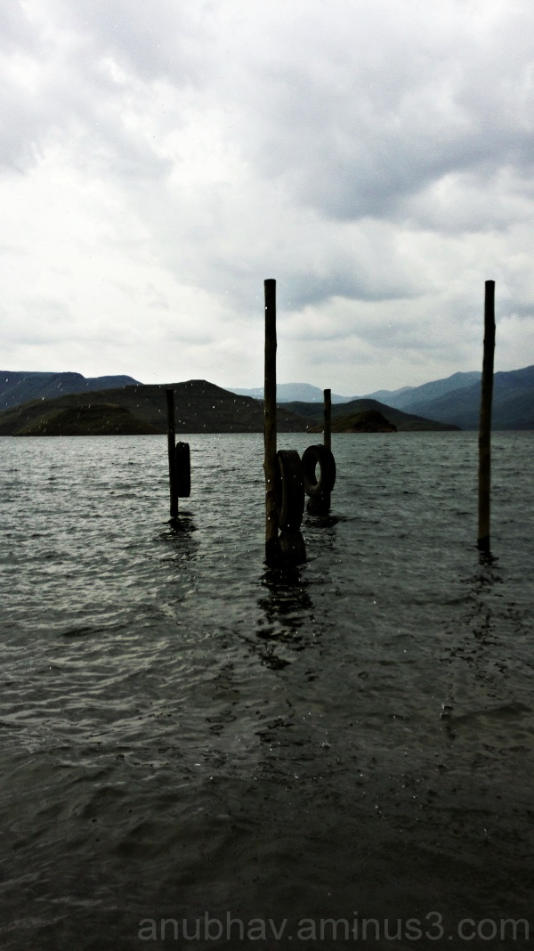 poles suspended in water