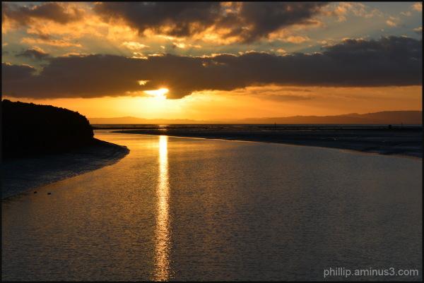 Sun set over water