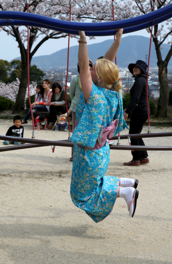 doing monkey bars with a kimono on