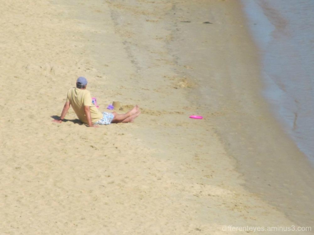 Man on Mornington beach