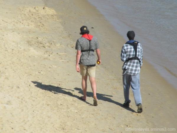 Walkers on Mornington beach...
