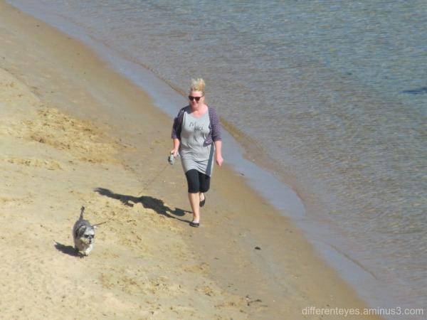 Woman and dog on a Mornington beach