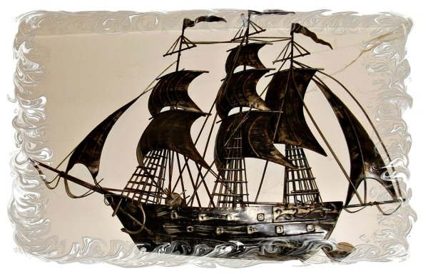 arty effect round a sailing ship ornament