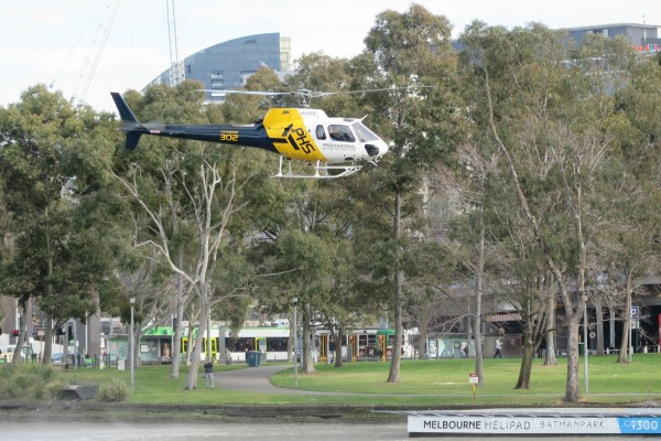 helicopter flying from Melbourne's Batman Park