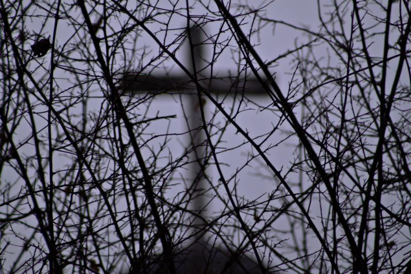 Cruz desenfocada