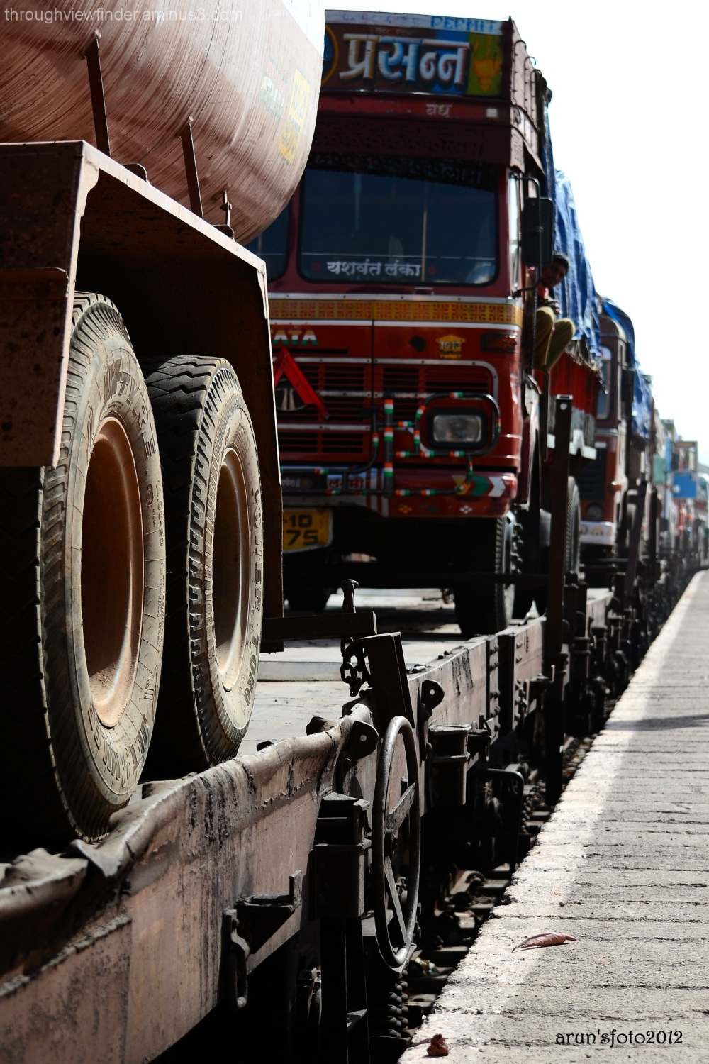 trucks carried by train from mumbai to manglore