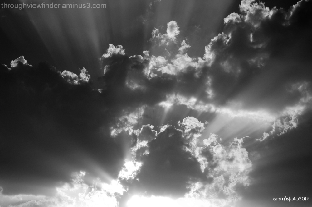 a capture of clouds and rays of light