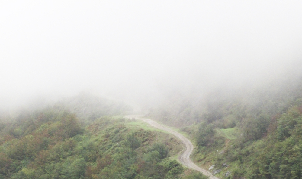 Mountainous Road in Fog