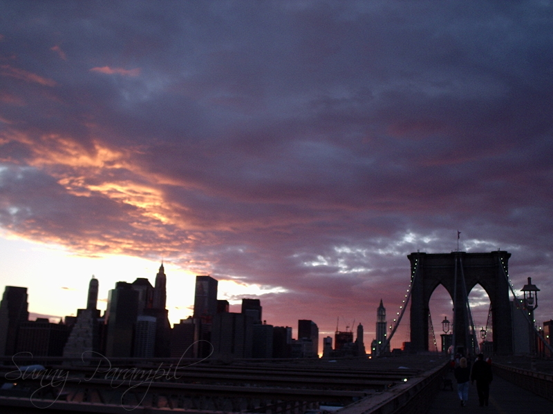 Brooklyn Bridge against NYC sunset