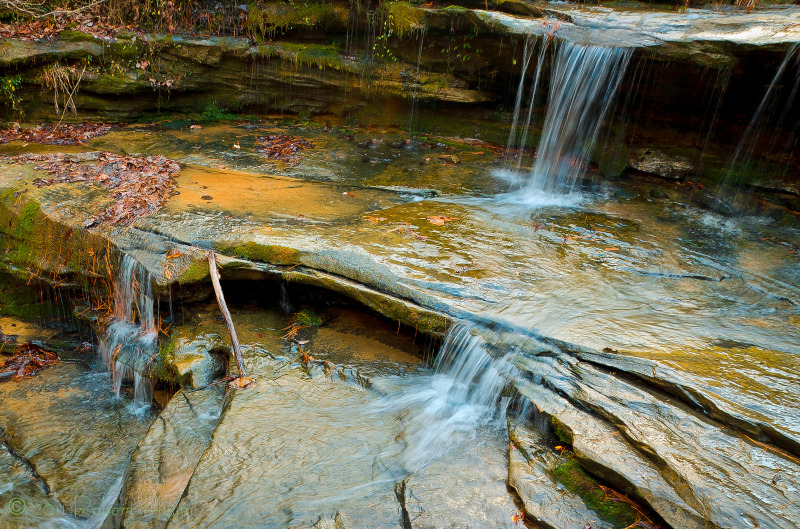 Water flows down rocky steps at Seven Falls Creek