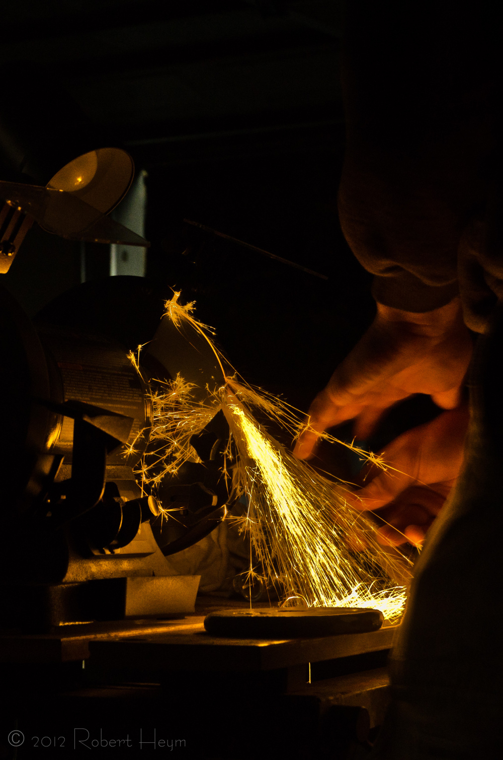 Sparks flying from a grinding wheel