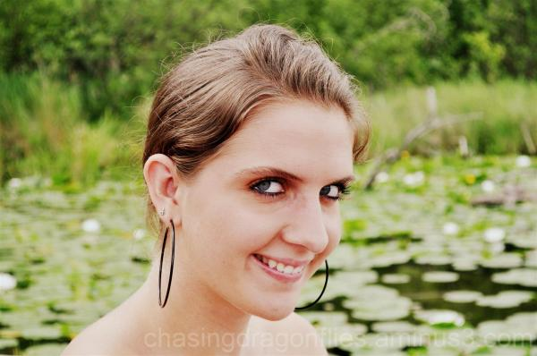 beautiful girl by a pond